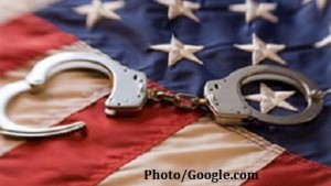 handcuffs+on+american+flag