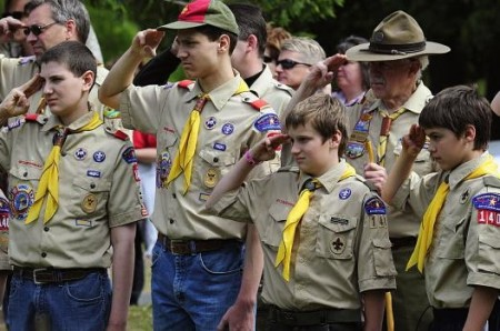Members of the Boy Scouts salute during
