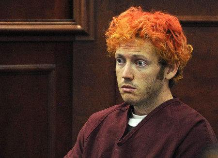 Colorado shooting suspect Holmes sits with public defender Brady during his first court appearance in Aurora