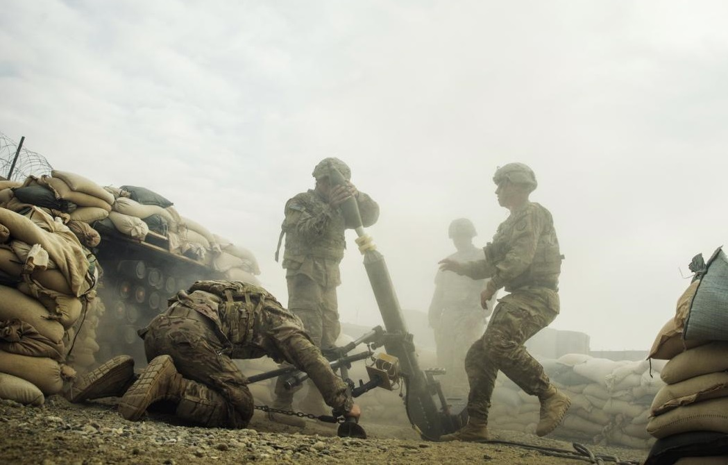 U.S. soldiers from the 3rd Cavalry Regiment fire a 120mm mortar during an exercise on forward operating base Gamberi in the Laghman province of Afghanistan December 24, 2014. (REUTERS/Lucas Jackson)
