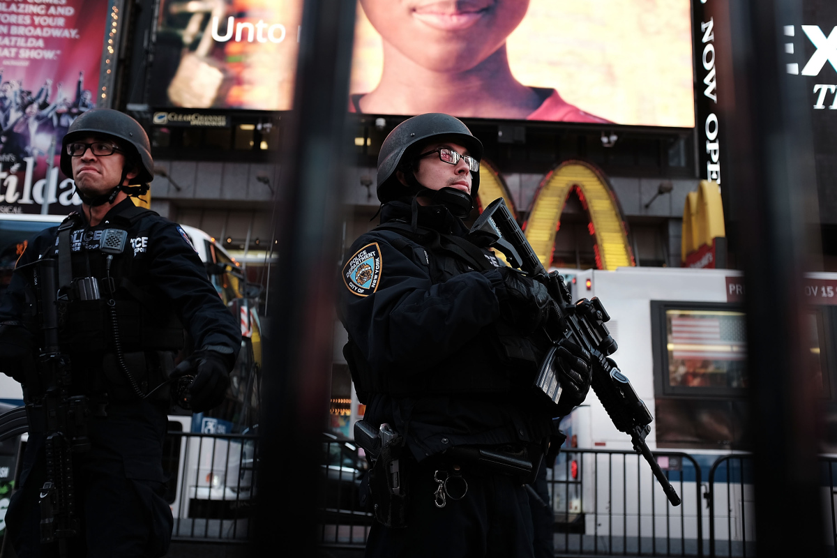 NEW YORK, NY - DECEMBER 07: New York police officers with high powered rifles patrol in Times Square on December 7, 2015 in New York City. Following a series of mass shootings in the U.S. and the terrorist attacks in Paris last month, security in many major American cities has increased while gun sale background checks are at an all time high.  (Photo by Spencer Platt/Getty Images)