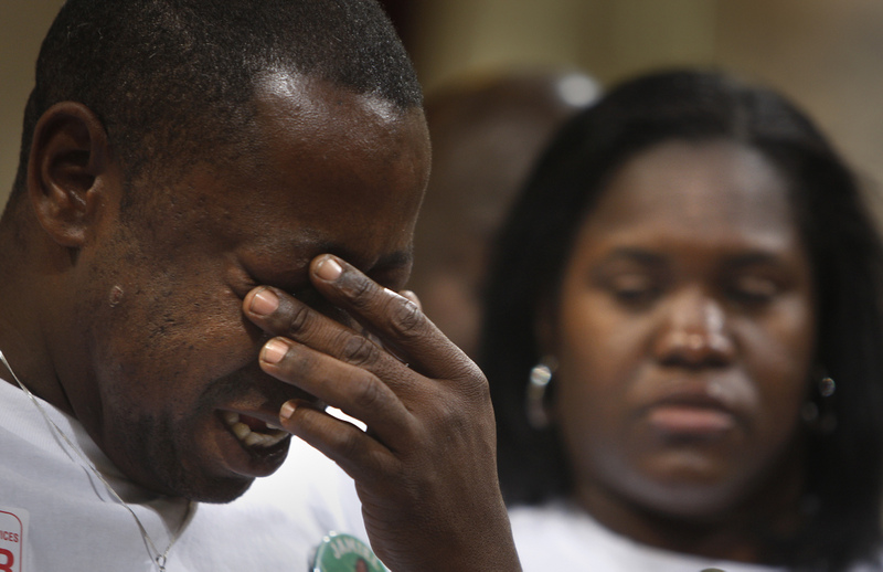 "136114.ME.0408.shaw.MJB-(Los Angeles)-Jamiel Shaw Sr. (left) weeps while standing with his wife Anita Shaw (right) before the Los Angeles City Council to plead for the passage of ""Jamiel's Law"" named for their son, who was slain by an alleged gang member last month. The law would allow the LAPD to crack down on gang members who are in the country illegally. April 8, 2008"